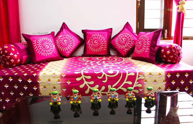 In colors of passion this majestic Diwan-set gifted our drawing room a vibrant touch blending well with the curtains.
