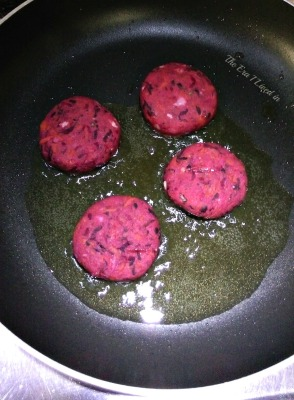 Beetroot & Carrot Cutlets being shallow fried in a non-stick pan