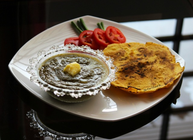Homemade authentic Sarson ka Saag recipe that pairs well with Makki di Roti. A winter staple from Punjab that's rich and tasty in every bite. #theerailivedin #SarsonKaSaagRecipe #WinterFoods #IndianRecipes #MakkiRoti